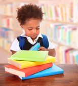 image of clever  - Little clever preschooler in the library - JPG