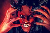 stock photo of hade  - Portrait of a devil with horns - JPG