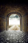 image of hazy  - Old Arch Gate opening to Endless Country Road leading nowhere - JPG
