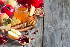 picture of pomegranate  - Pomegranate apple and honey traditional food of jewish New Year celebration Rosh Hashana - JPG