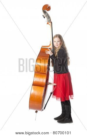 Young Girl Leans Against Double Bass In Studio
