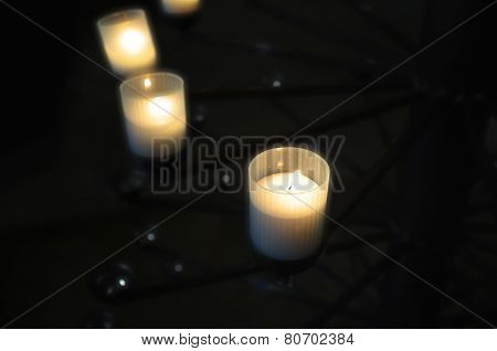 lighted candles arranged arc