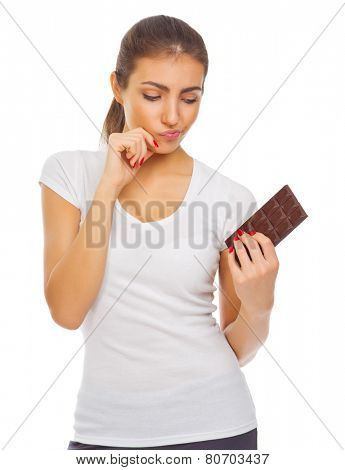 Young doubting girl with chocolate isolated