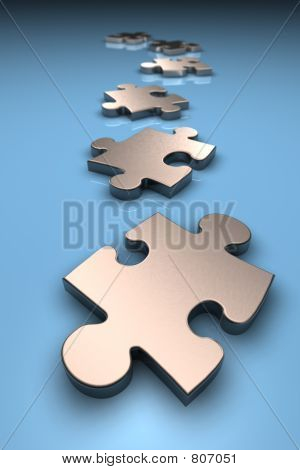 Metallic puzzle pieces