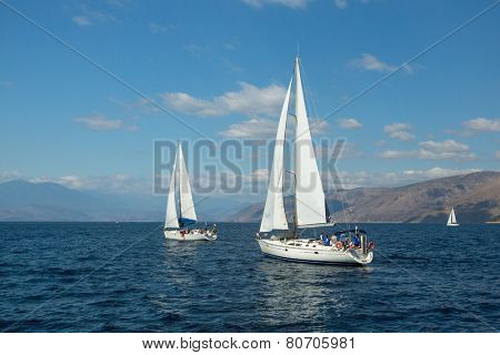 GALAXIDI, GREECE - SEP 29, 2014: Unidentified sailboats participate in sailing regatta
