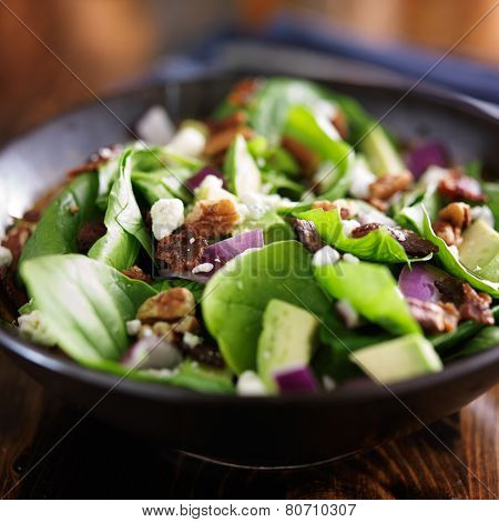 avocado spinach salad close up in bowl
