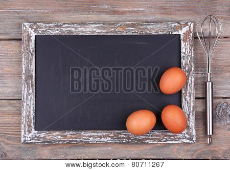 Blackboard blank on rustic wooden planks background
