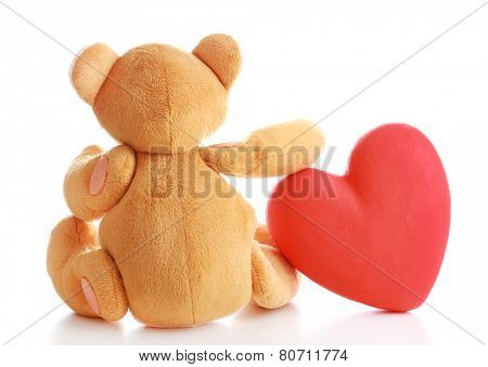Teddy Bear with red heart isolated on white