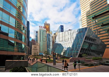 HONG KONG - DECEMBER 11, 2014: Hong Kong Special Administrative Region. Mirrored walls and red marble sidewalks. Super-modern architectural design of buildings in Hong Kong