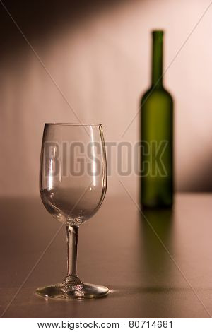 A wineglass and a bottle