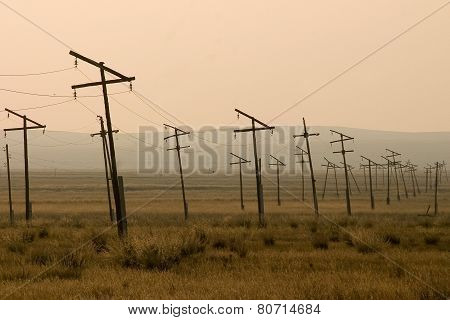 Electricity pylons in grassland, Mongolia