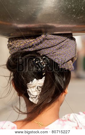 Myanmar Woman Carrying On Her Head