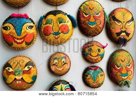 Faces Painted On Woven Round Bamboo Trays In Hanoi