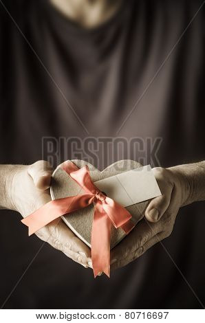 Man Presenting Heart Box Gift