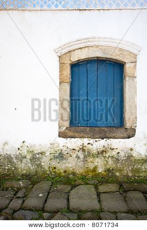 Blue window over walkway - Paraty, Brazil