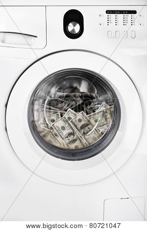 Money in washing machine, closeup view