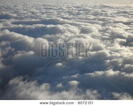 On Top Of Fluffy Curvy Clouds