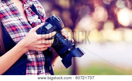 Young photographer taking photos outdoors