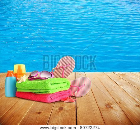 Bright beach accessories on sea background