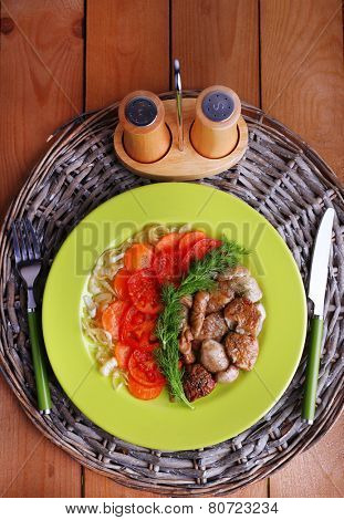 Braised wild mushrooms with vegetables and spices on plate on table