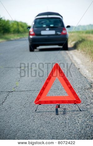 Car With Red Warning Triangle