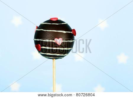 Tasty cake pop on blue background