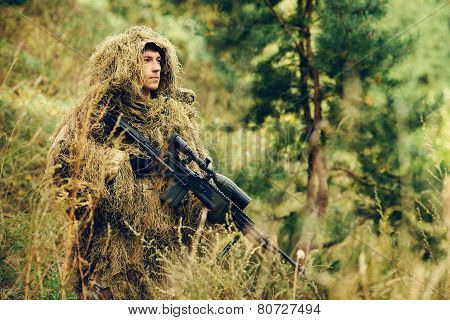Sniper Soldier Stands With Arms And Looking At The Target