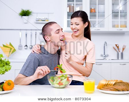 Happy Flirting Couple In The Kitchen