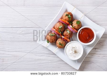 Meatballs On Skewers And Sauces Horizontal Top View
