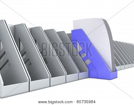 Blue Paper Tray Stands Out Among The Paper Trays