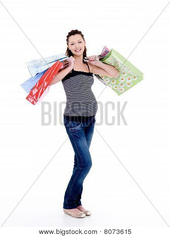 Smiling Pregnant Woman With Shopping Bags