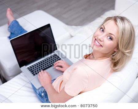 Pretty Smiling Woman Using Laptop