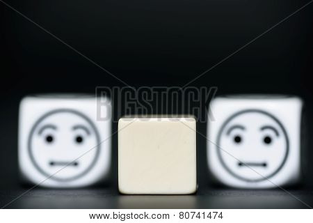 Blank Dice With Emoticon Dice (confused) In Background