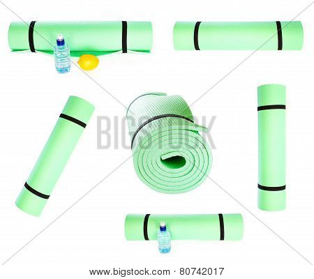 Set Of Lightweight Foam Yoga Mat Roll Isolated On White Background. Sport Equipment