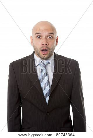 Astonished And Surprised Hispanic Businessman In Suit And Tie Looking Scared, Clueless And Confused
