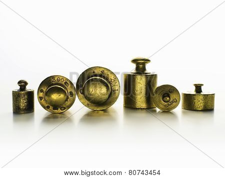Brass Weights Of An Old Weighing Scale