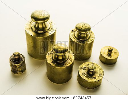 Six Brass Weights Of An Old Weighing Scale