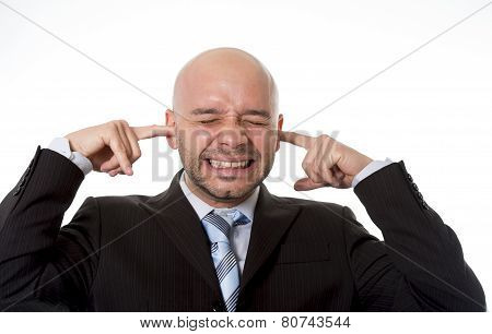 Brazilian Businessman Wearing Suit And Tie In Stress Covering His Ears With Fingers Hoping For Noise