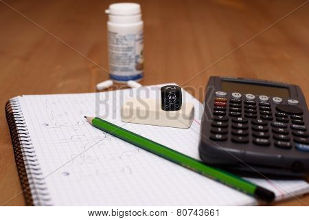 Study Place With Calculator And Painkillers In Background