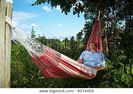 Man Taking A Break In A Hammock
