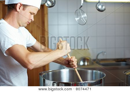 Chef Stirring In A Pot
