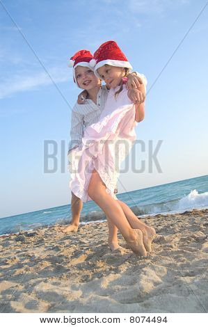 Santa Kids At The Summer Beach