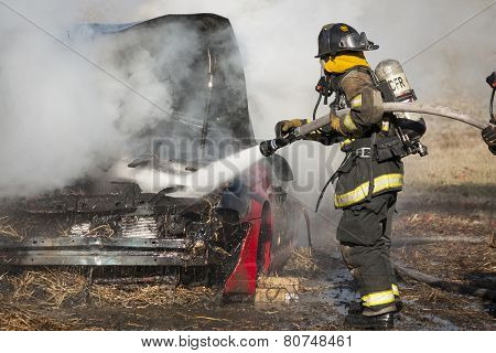 Firemen training on a burning car at the New Baltimore Fire Station