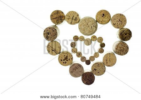 Wine corks form a heart shape image isolated on white background