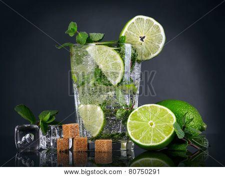 Mojito cocktail over black background