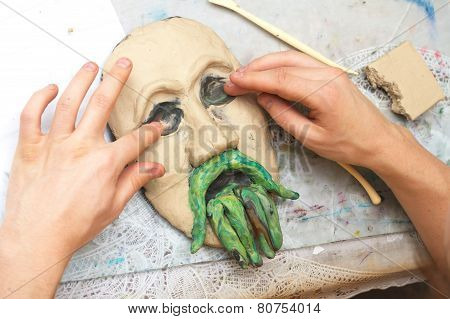 Hands Sculpting Plasticine Form Of Face