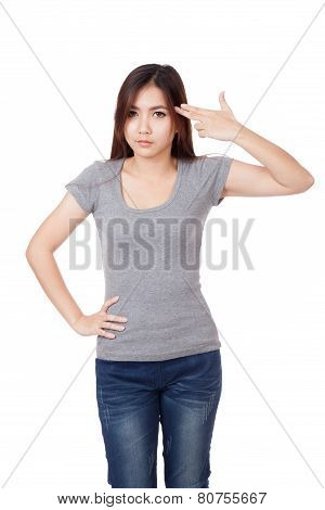 Young Asian Woman Gesturing  Gun To Head