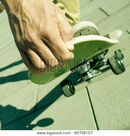 closeup of a young man performing a trick with his skate