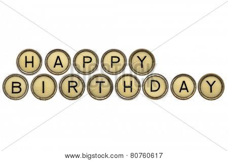 Happy Birthday wishes  in old round typewriter keys isolated on white