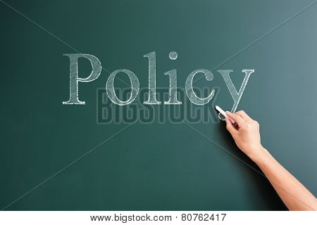 policy written on blackboard